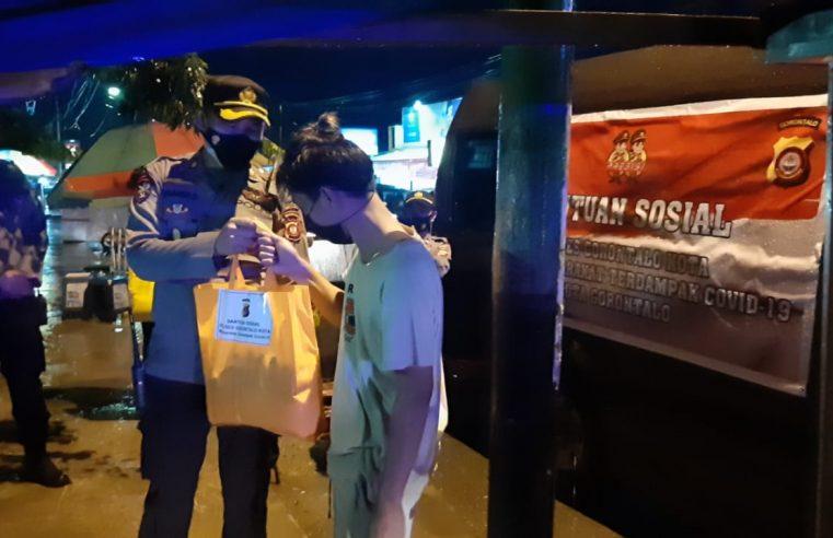 BANTUAN SOSIAL POLRES GORONTALO KOTA KEPADA MASYARAKAT YANG BERDAMPAK COVID-19 & PPKM